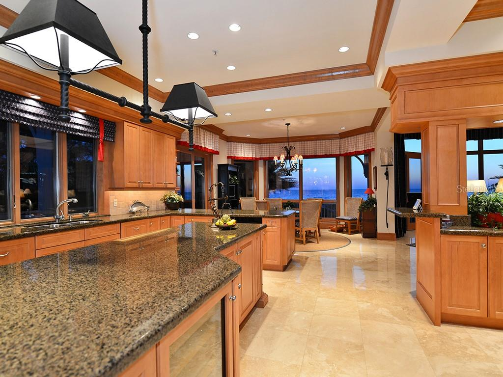 Spacious chef Kitchen Overlooking Intimate Dining Area - Single Family Home for sale at 6301 Gulf Of Mexico Dr, Longboat Key, FL 34228 - MLS Number is A4460816