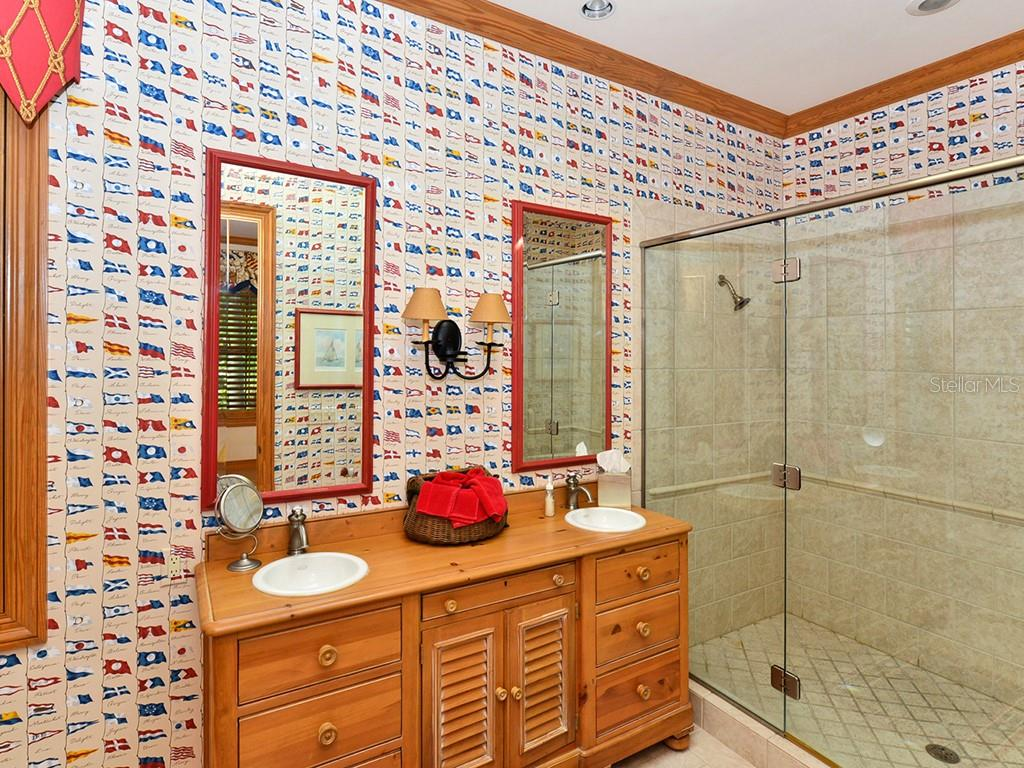 Guest Bathroom #1 - Single Family Home for sale at 6301 Gulf Of Mexico Dr, Longboat Key, FL 34228 - MLS Number is A4460816