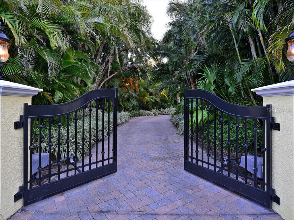 Gated Entry & Meandering Drive - Single Family Home for sale at 6301 Gulf Of Mexico Dr, Longboat Key, FL 34228 - MLS Number is A4460816