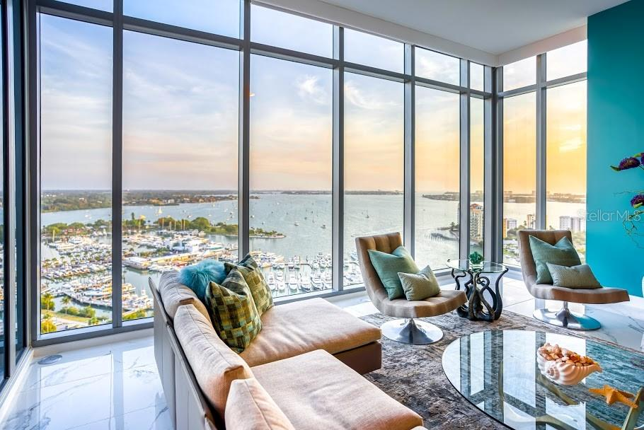 Sweeping views and sun is setting off the family room - Condo for sale at 1155 N Gulfstream Ave #1909, Sarasota, FL 34236 - MLS Number is A4461040