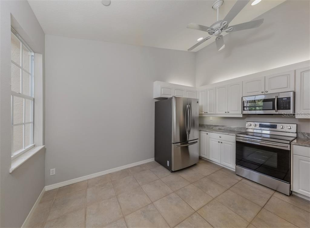 Kitchen - Condo for sale at 119 Woodbridge Dr #204, Venice, FL 34293 - MLS Number is A4461406