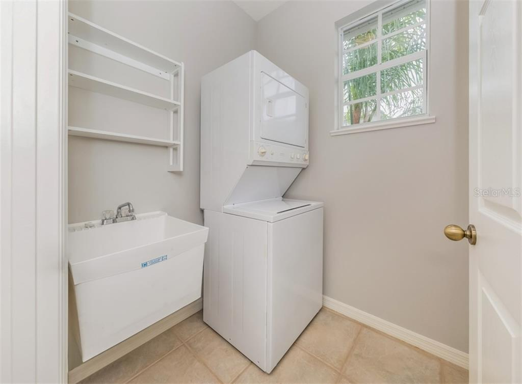 Laundry room - Condo for sale at 119 Woodbridge Dr #204, Venice, FL 34293 - MLS Number is A4461406