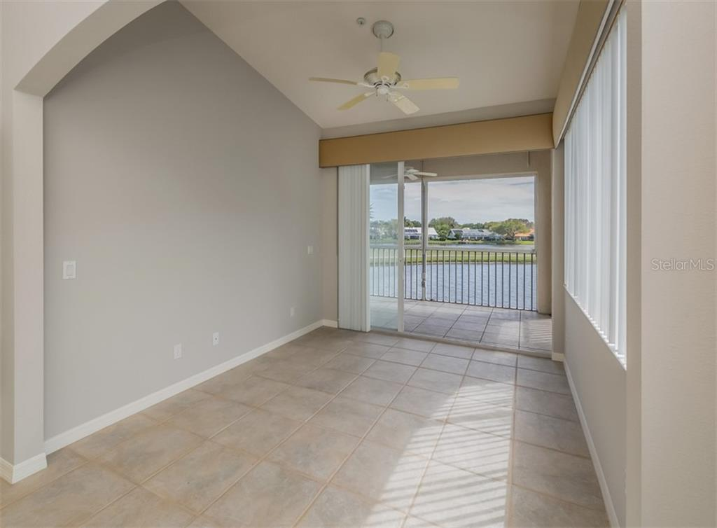 Florida room with sliders to lanai - Condo for sale at 119 Woodbridge Dr #204, Venice, FL 34293 - MLS Number is A4461406