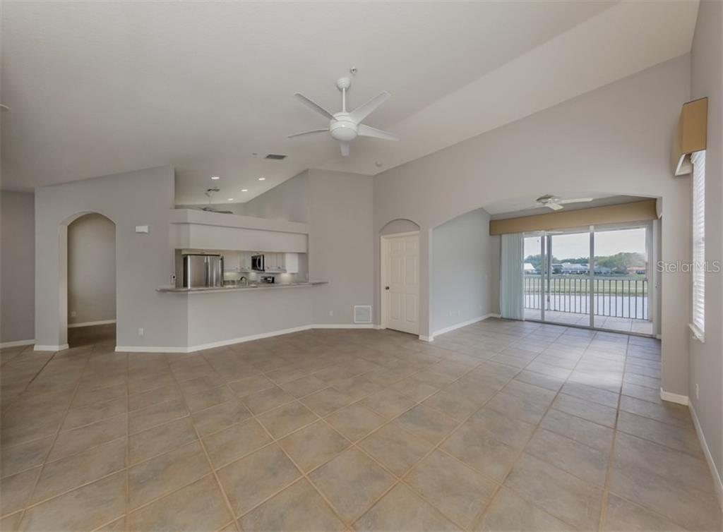 Living/dining room - Condo for sale at 119 Woodbridge Dr #204, Venice, FL 34293 - MLS Number is A4461406