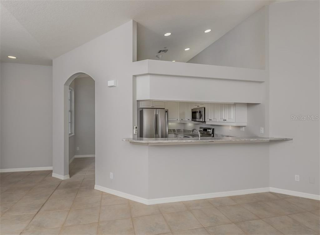 Breakfast bar, kitchen - Condo for sale at 119 Woodbridge Dr #204, Venice, FL 34293 - MLS Number is A4461406