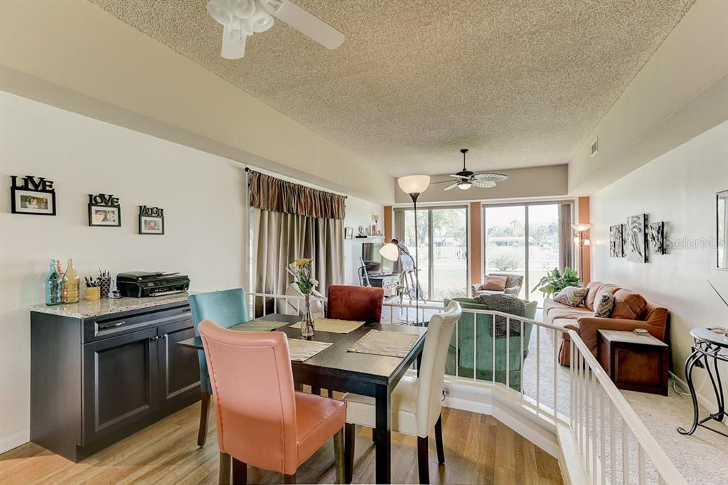 Living Room and Dining Space - Condo for sale at 2319 Lakeside Mews #B3, Sarasota, FL 34235 - MLS Number is A4462396