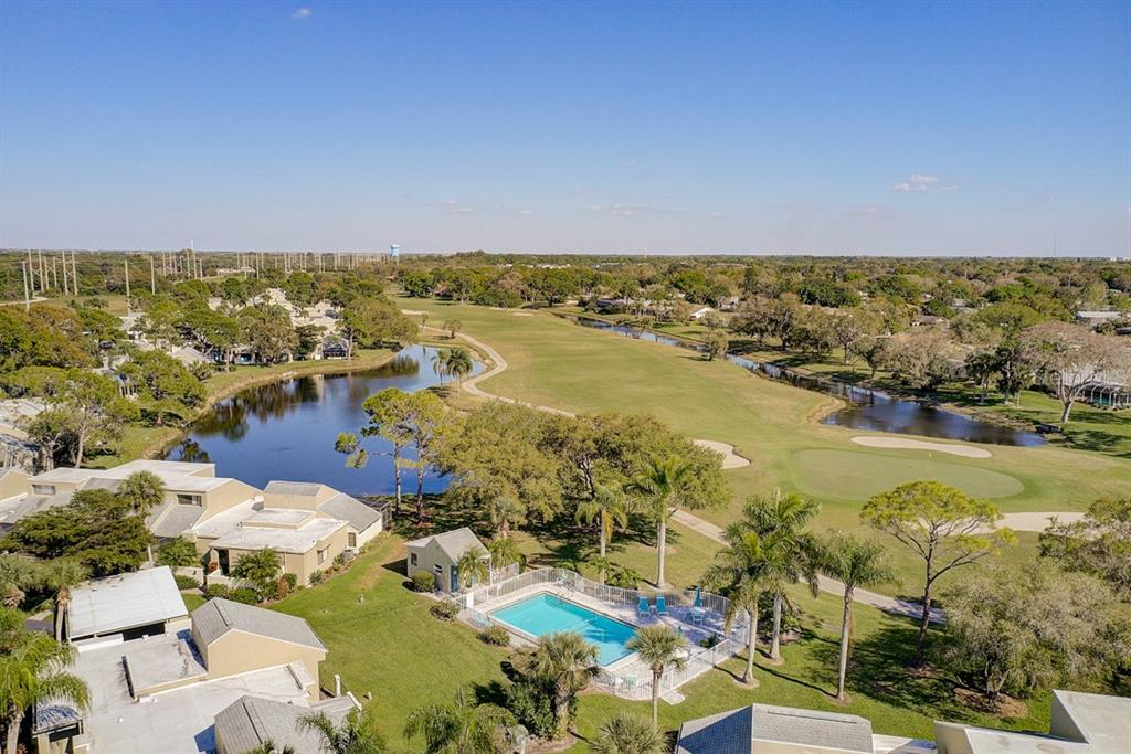Home, Pool, and Golf Course from Aerial Drone - Condo for sale at 2319 Lakeside Mews #B3, Sarasota, FL 34235 - MLS Number is A4462396