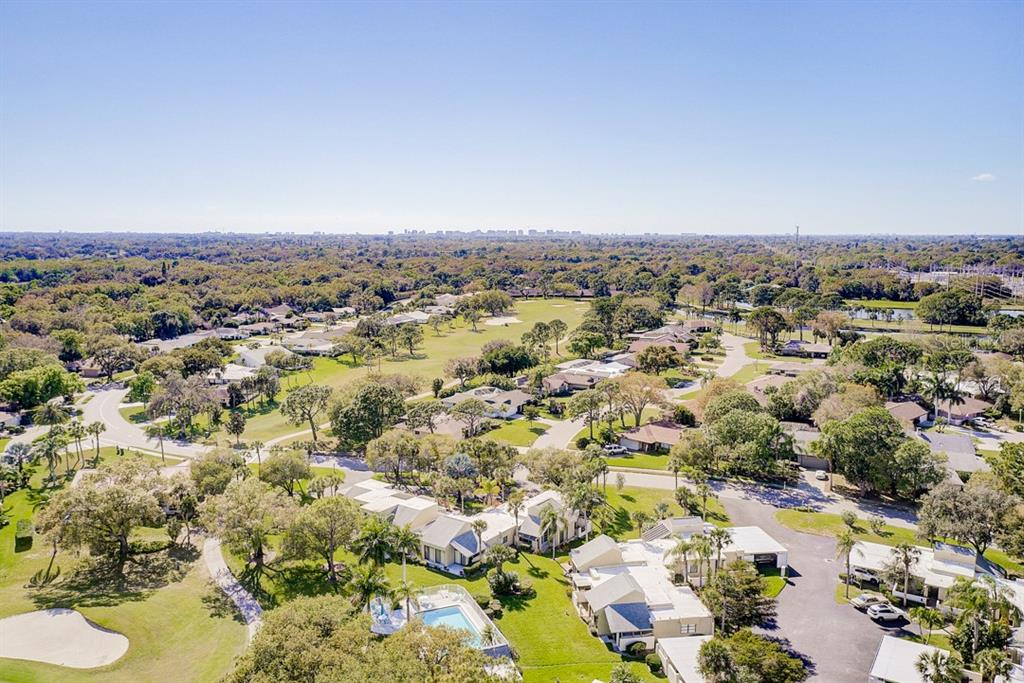 Aerial Drone shot above community and pool - Condo for sale at 2319 Lakeside Mews #B3, Sarasota, FL 34235 - MLS Number is A4462396