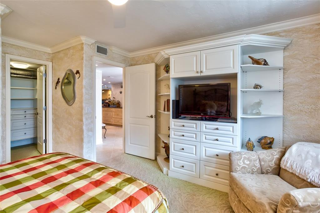 Includes built in storage and walk-in closet with organizers - Condo for sale at 5880 Midnight Pass Rd #911, Sarasota, FL 34242 - MLS Number is A4462559
