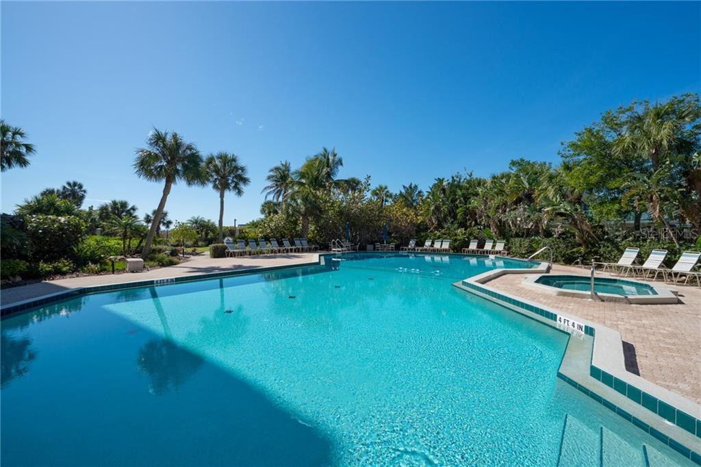 Casarina's heated pool with swimming lane indicators - Condo for sale at 5880 Midnight Pass Rd #911, Sarasota, FL 34242 - MLS Number is A4462559
