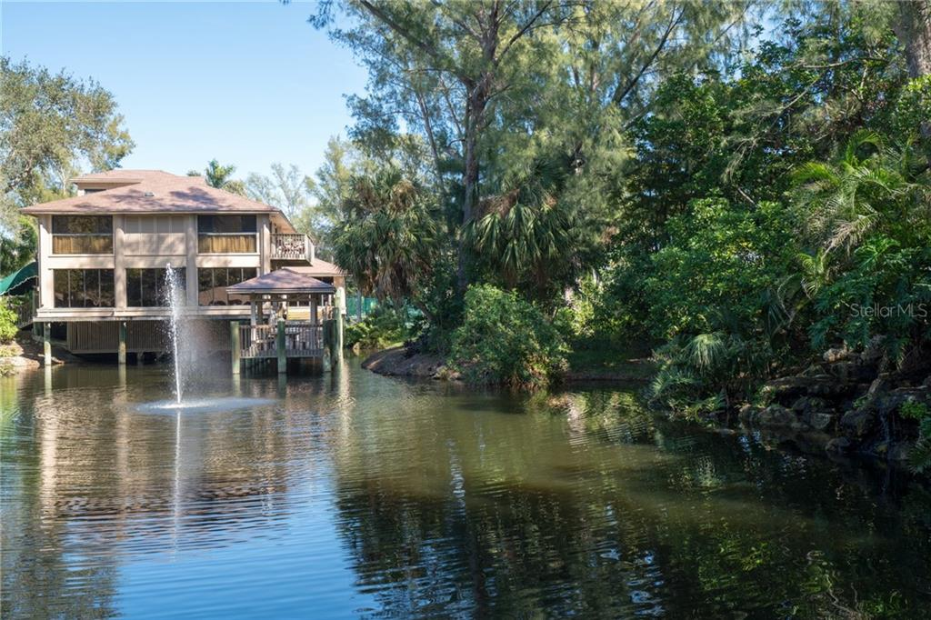 The Casarina Clubhouse and the lake with fountain - Condo for sale at 5880 Midnight Pass Rd #911, Sarasota, FL 34242 - MLS Number is A4462559