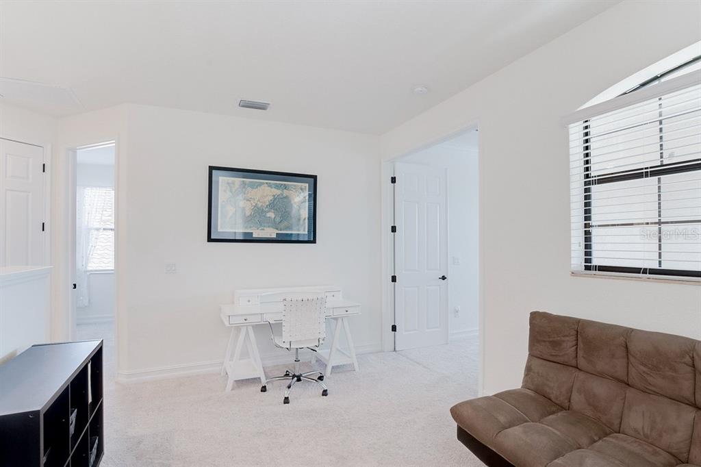 Loft area - perfect for a playroom, office, craft room, etc. - Single Family Home for sale at 5531 Arnie Loop, Bradenton, FL 34211 - MLS Number is A4463553