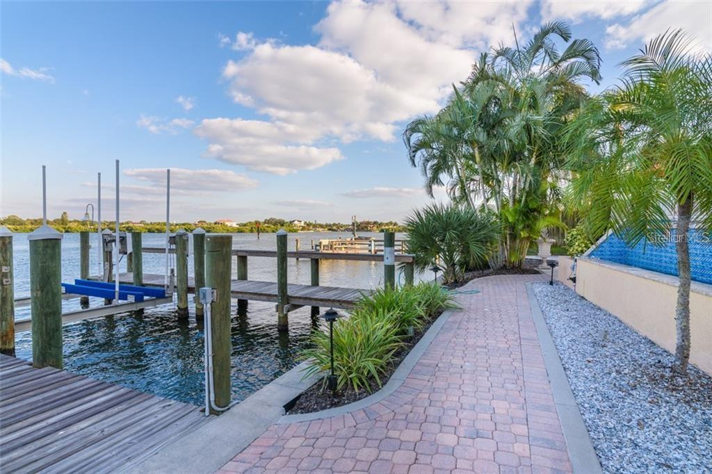 Boat dock with lift - Condo for sale at 5923 Midnight Pass Rd #3, Sarasota, FL 34242 - MLS Number is A4465178