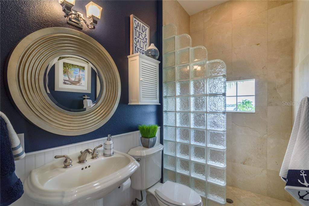 Guest bath - Condo for sale at 5923 Midnight Pass Rd #3, Sarasota, FL 34242 - MLS Number is A4465178