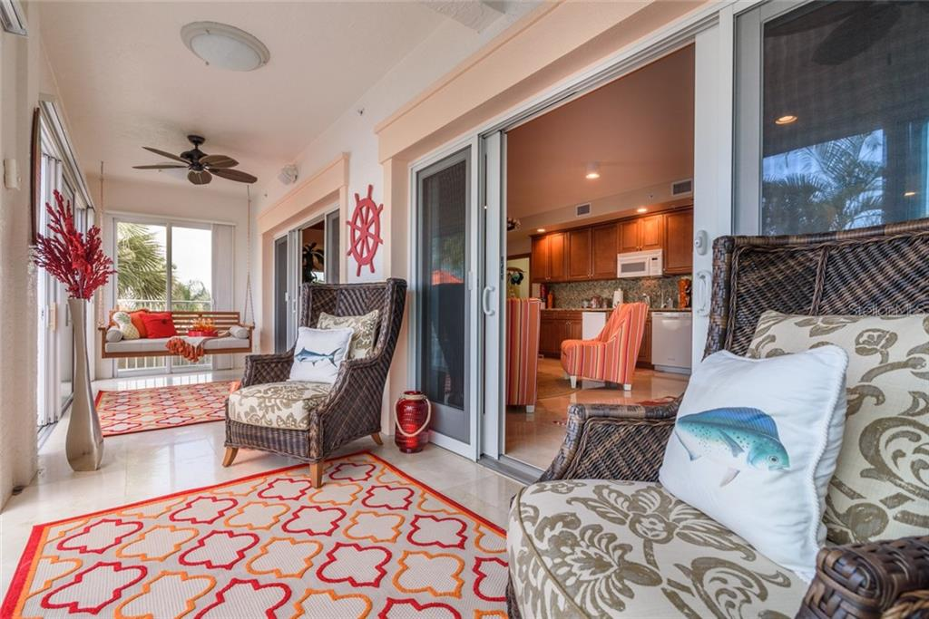 Four Season Lanai off Bonus Room near Pool - Condo for sale at 5923 Midnight Pass Rd #3, Sarasota, FL 34242 - MLS Number is A4465178