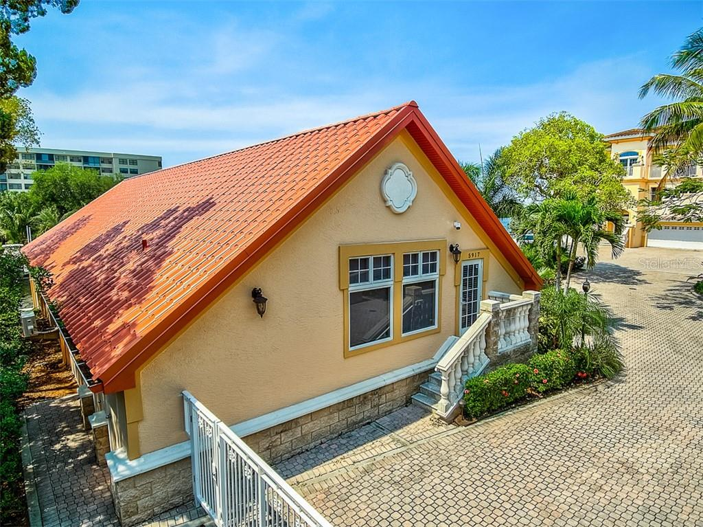 Detached Boathouse with Studio Apartment. New Metal Roof. - Condo for sale at 5923 Midnight Pass Rd #3, Sarasota, FL 34242 - MLS Number is A4465178