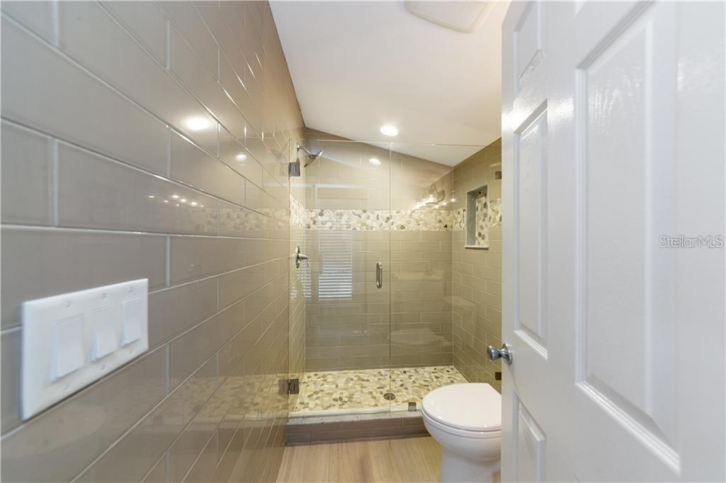 Boathouse Studio Bathroom - Condo for sale at 5923 Midnight Pass Rd #3, Sarasota, FL 34242 - MLS Number is A4465178