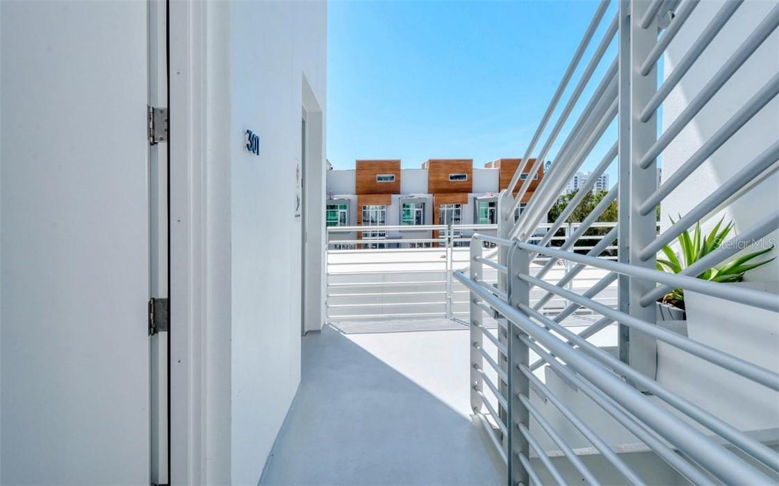From your front door you will appreciate the sity skyline and contemporary architecture the community building offers. - Condo for sale at 1350 5th Street #301, Sarasota, FL 34236 - MLS Number is A4466172