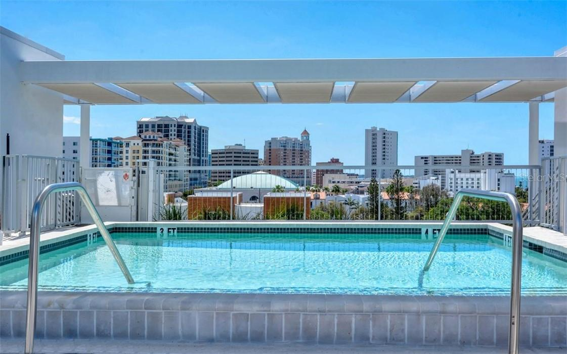 Sunshields shade you from the sun above the flying roof top observation decks, pool deck and penthouse level walkway. - Condo for sale at 1350 5th Street #301, Sarasota, FL 34236 - MLS Number is A4466172