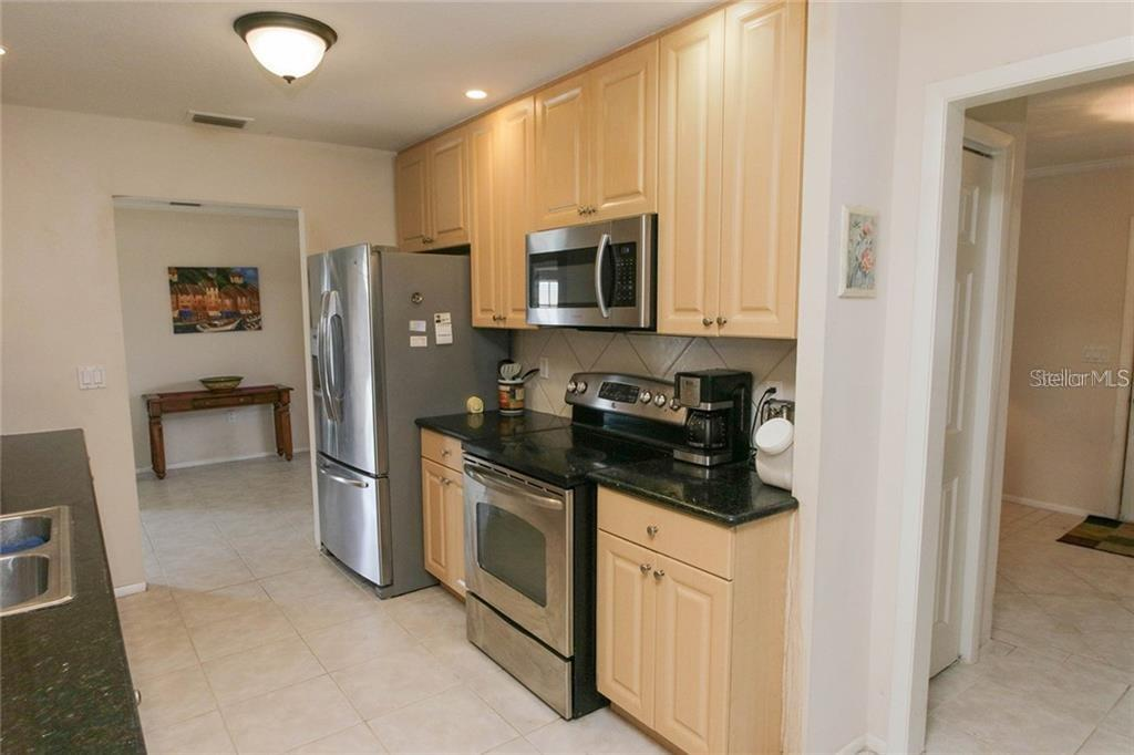 Kitchen - Single Family Home for sale at 7403 13th Avenue Dr W, Bradenton, FL 34209 - MLS Number is A4466662