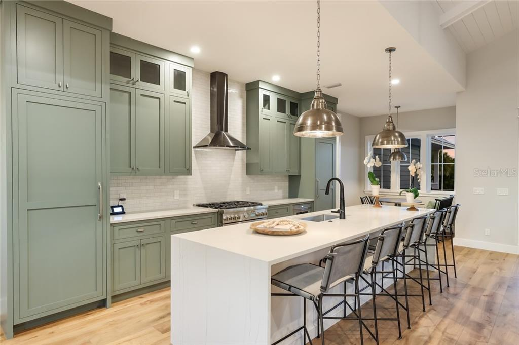 Gourmet kitchen with all thermador appliances and gorgeous quartz counter tops! - Single Family Home for sale at 217 Willow Ave, Anna Maria, FL 34216 - MLS Number is A4466825