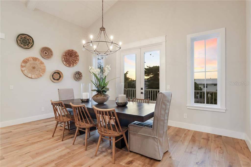 Dining room off of the kitchen!  Doors that lead you to a front porch where you can watch amazing sunsets - Single Family Home for sale at 217 Willow Ave, Anna Maria, FL 34216 - MLS Number is A4466825
