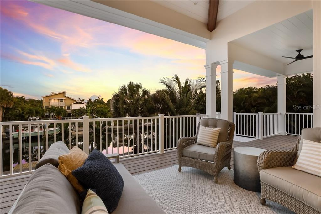 Upstairs porch at sunset off of the living room! - Single Family Home for sale at 217 Willow Ave, Anna Maria, FL 34216 - MLS Number is A4466825