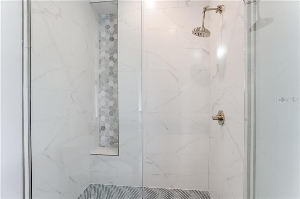 En suite bathroom to bedroom #1 - large stand up shower - Single Family Home for sale at 217 Willow Ave, Anna Maria, FL 34216 - MLS Number is A4466825