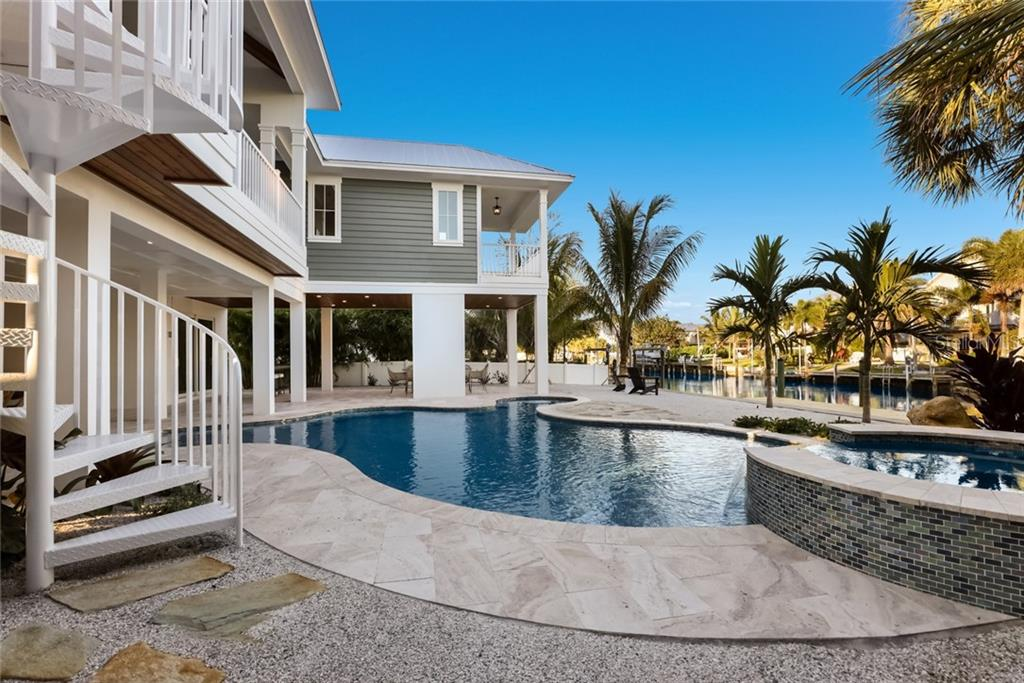 Take the spiral stairs down to your luxury pool/heated spa! - Single Family Home for sale at 217 Willow Ave, Anna Maria, FL 34216 - MLS Number is A4466825