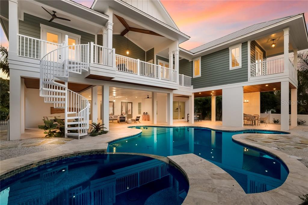 Beautiful lighting in the pool area! - Single Family Home for sale at 217 Willow Ave, Anna Maria, FL 34216 - MLS Number is A4466825