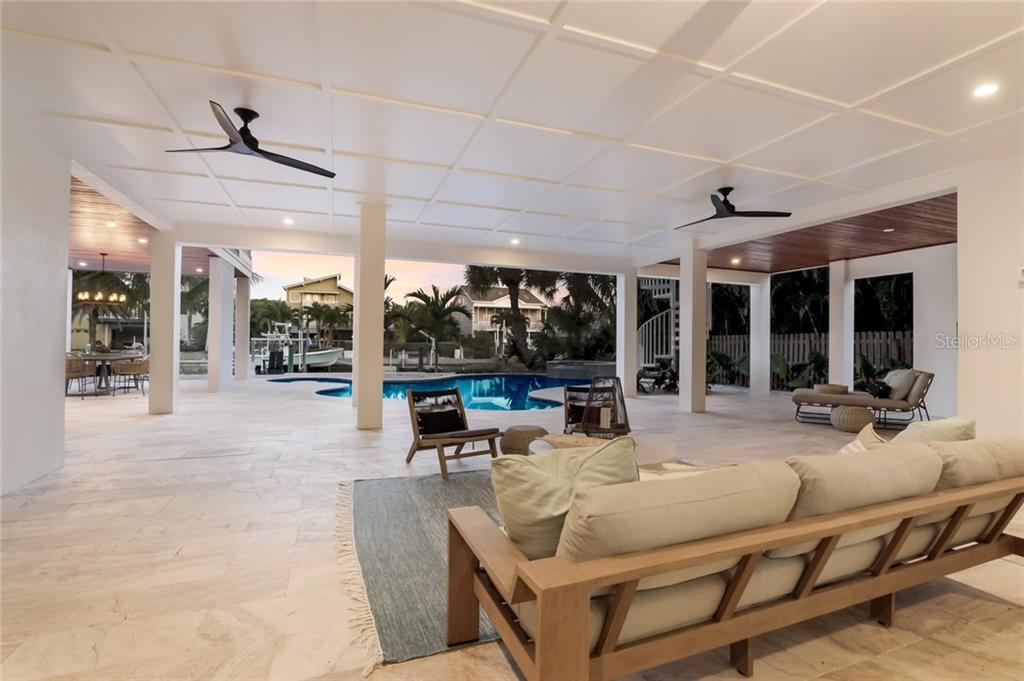 Happy hour poolside!  Travertine floors and outstanding views! - Single Family Home for sale at 217 Willow Ave, Anna Maria, FL 34216 - MLS Number is A4466825