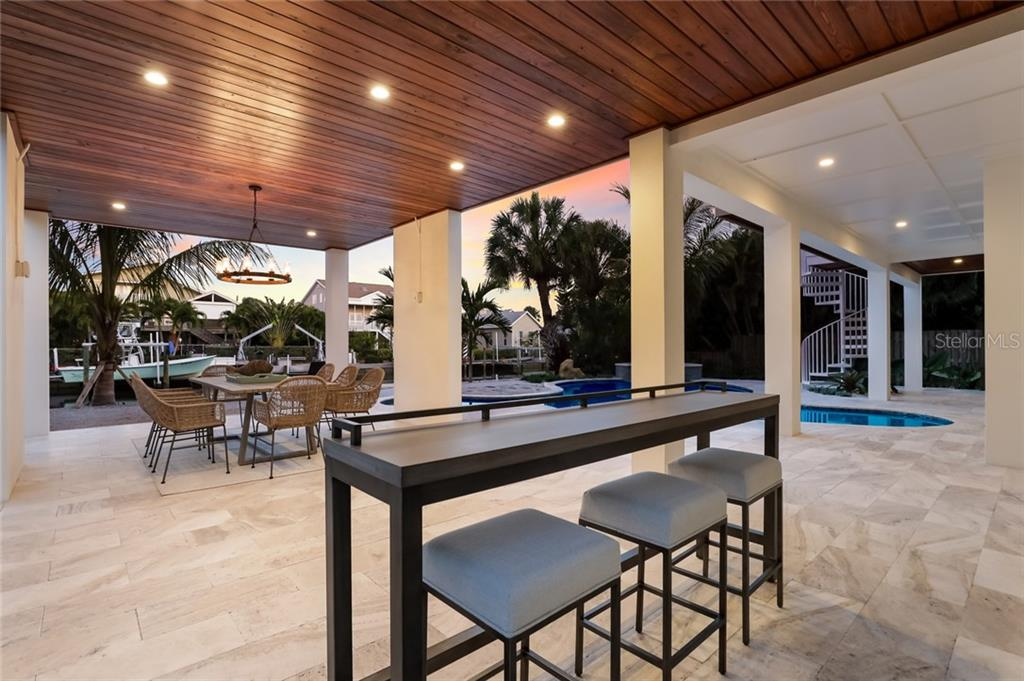 Dine pool side while you watch boats go by - Single Family Home for sale at 217 Willow Ave, Anna Maria, FL 34216 - MLS Number is A4466825