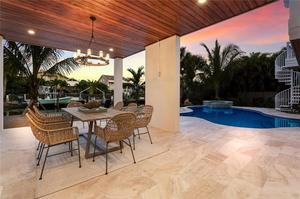 Family meals in a beautiful setting outside! - Single Family Home for sale at 217 Willow Ave, Anna Maria, FL 34216 - MLS Number is A4466825