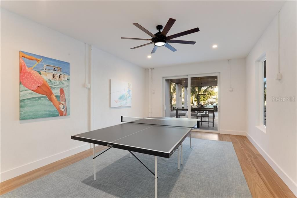 Large game room with sliding doors off of the pool area! - Single Family Home for sale at 217 Willow Ave, Anna Maria, FL 34216 - MLS Number is A4466825