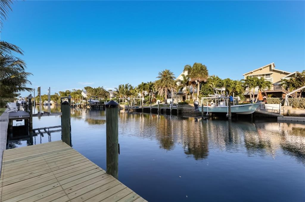 New seawall and wood dock - Single Family Home for sale at 217 Willow Ave, Anna Maria, FL 34216 - MLS Number is A4466825