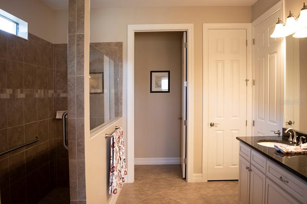 walk - in roman shower in the master bath with separate water closet - Single Family Home for sale at 11196 Whimbrel Ln, Sarasota, FL 34238 - MLS Number is A4471096