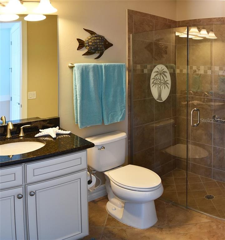 guest bathroom #2 ensuite with walk-in shower - Single Family Home for sale at 11196 Whimbrel Ln, Sarasota, FL 34238 - MLS Number is A4471096