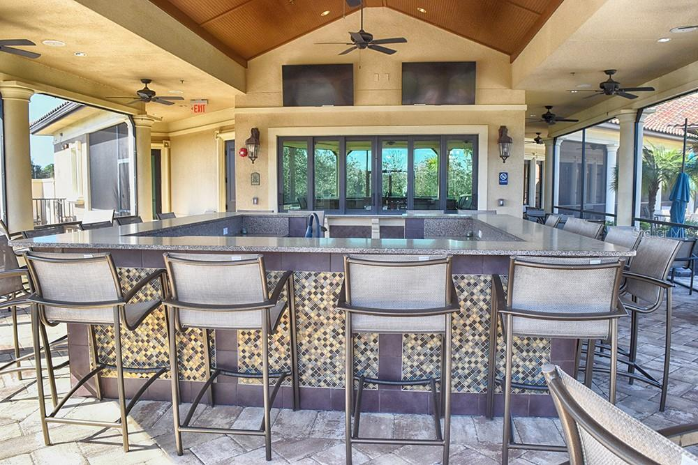 at the community pool - Single Family Home for sale at 11196 Whimbrel Ln, Sarasota, FL 34238 - MLS Number is A4471096