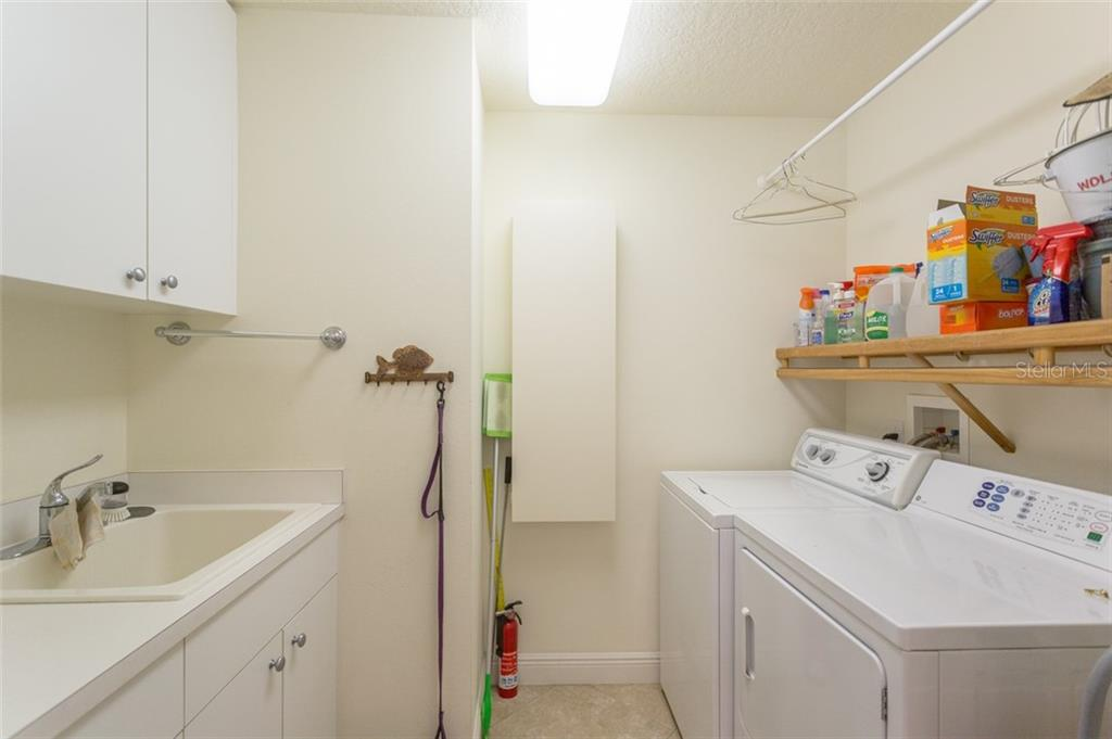 Large laundry room - Condo for sale at 1308 Old Stickney Point Rd #W24, Sarasota, FL 34242 - MLS Number is A4471155