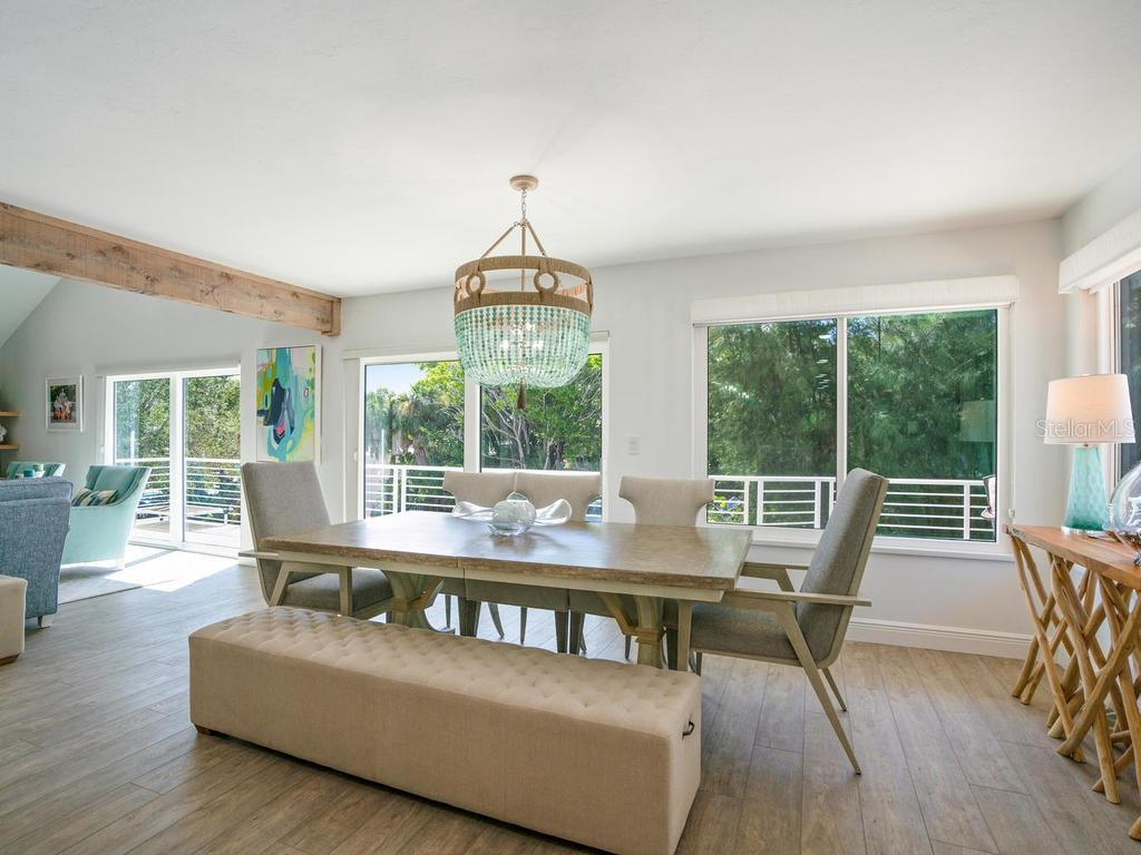 Dining room opens to wrap around balcony - Single Family Home for sale at 500 Beach Rd #1, Sarasota, FL 34242 - MLS Number is A4474527