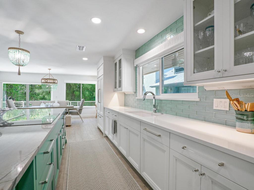 Sleek upgraded Campbell cabinetry in kitchen - Single Family Home for sale at 500 Beach Rd #1, Sarasota, FL 34242 - MLS Number is A4474527