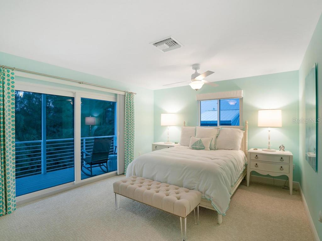 Sunset guest bedroom view - Single Family Home for sale at 500 Beach Rd #1, Sarasota, FL 34242 - MLS Number is A4474527