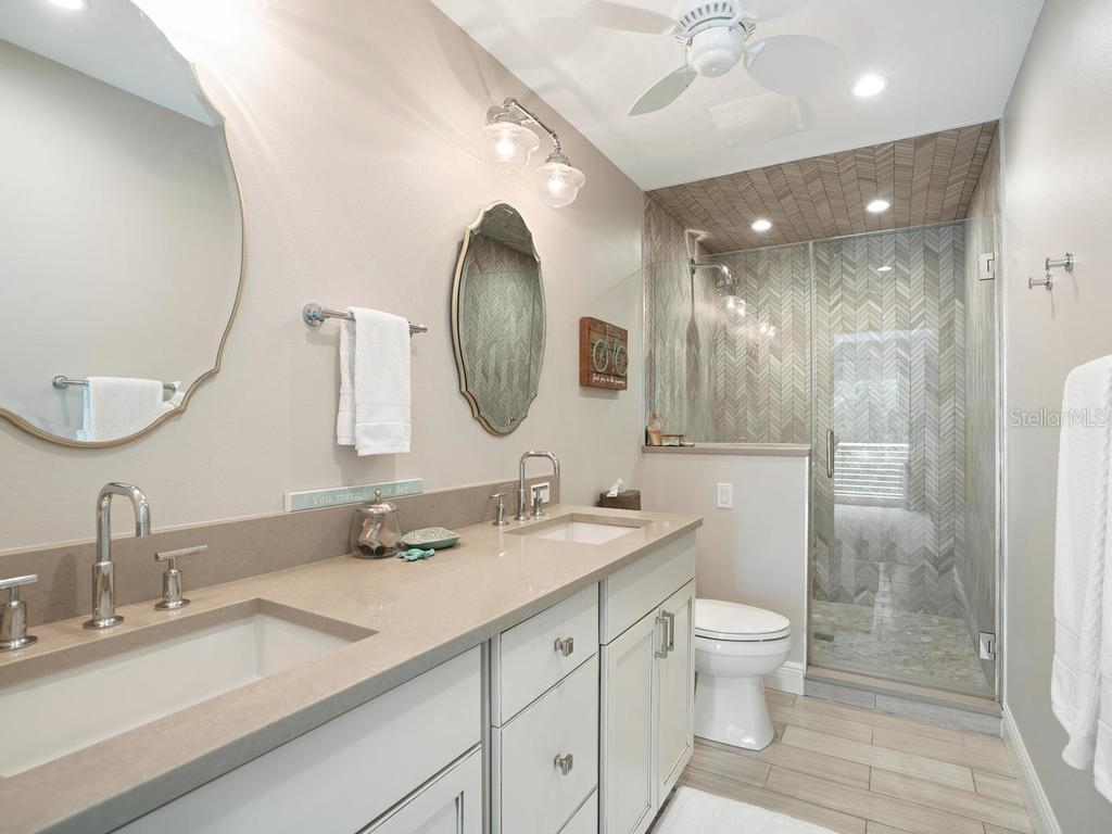 Guest bathroom with dual sinks and shower - Single Family Home for sale at 500 Beach Rd #1, Sarasota, FL 34242 - MLS Number is A4474527