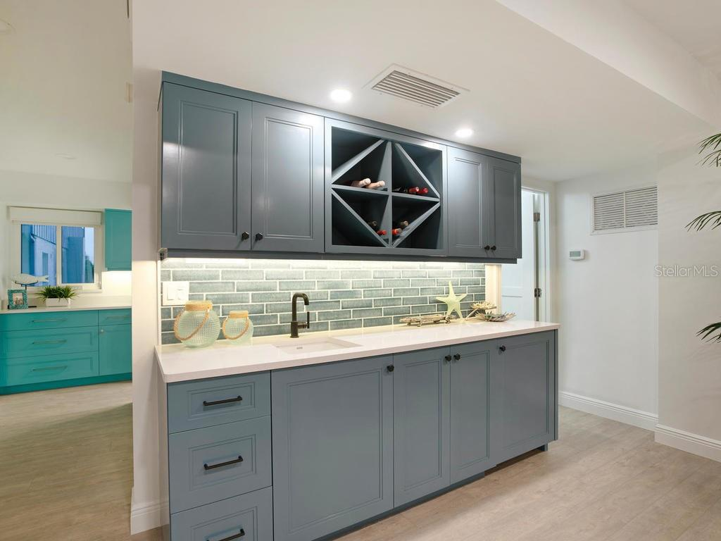 Wet bar with wine cooler and storage cabinets - Single Family Home for sale at 500 Beach Rd #1, Sarasota, FL 34242 - MLS Number is A4474527