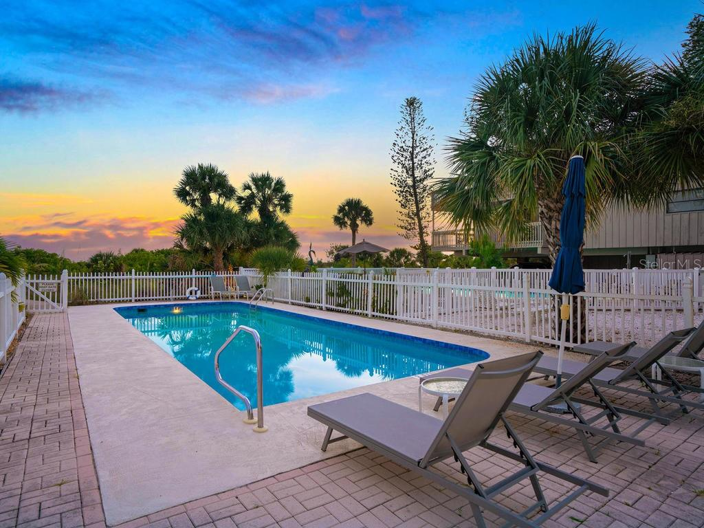 Community pool at sunset - Single Family Home for sale at 500 Beach Rd #1, Sarasota, FL 34242 - MLS Number is A4474527