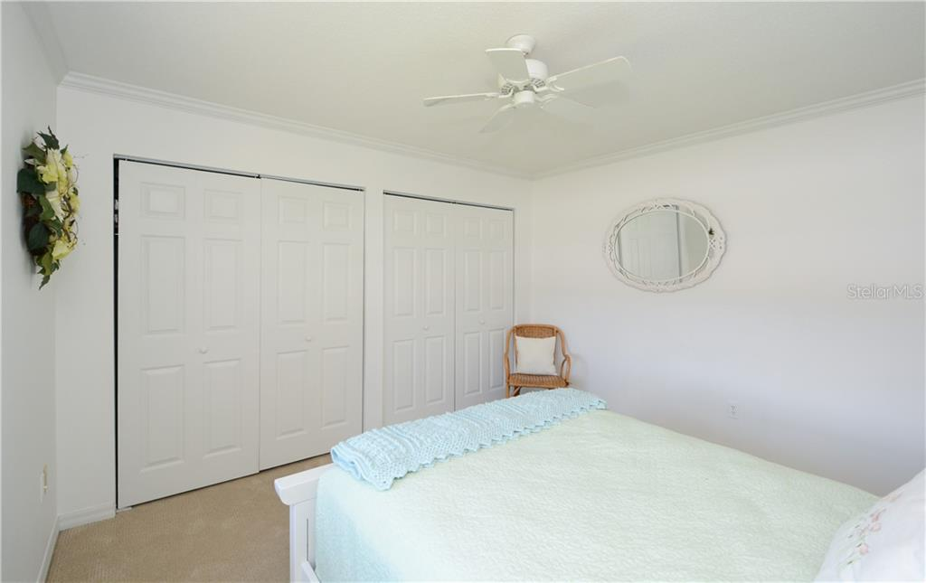 Guest bedroom with two double wide closets - Villa for sale at 1321 Glen Oaks Dr E #132, Sarasota, FL 34232 - MLS Number is A4474656