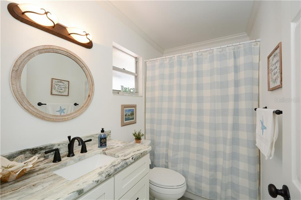Guest bathroom with new vanity, stone countertop, tub and shower - Villa for sale at 1321 Glen Oaks Dr E #132, Sarasota, FL 34232 - MLS Number is A4474656