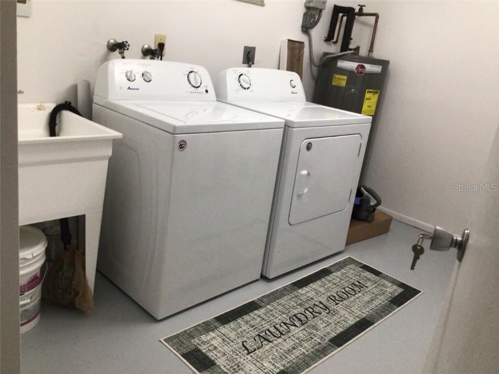 Air conditioned laundry room with new laundry sink - Villa for sale at 1321 Glen Oaks Dr E #132, Sarasota, FL 34232 - MLS Number is A4474656
