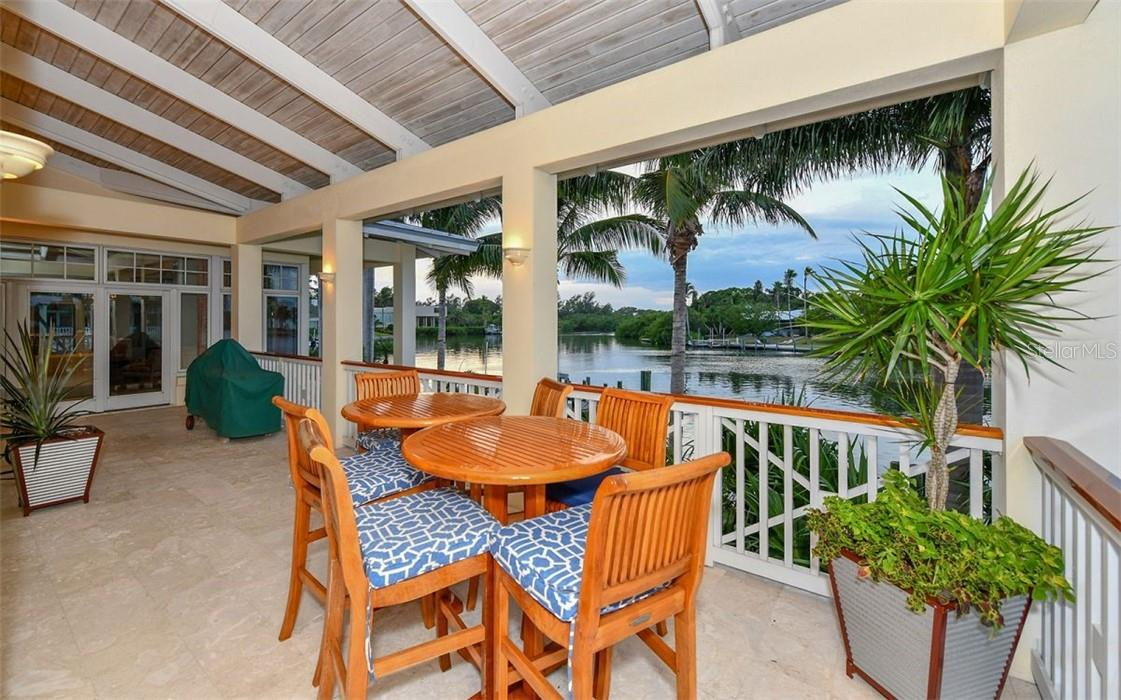 Living room porch and grill area - Single Family Home for sale at 612 Juan Anasco Dr, Longboat Key, FL 34228 - MLS Number is A4475444