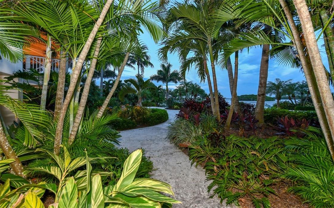 Pathway from pool to third dock - Single Family Home for sale at 612 Juan Anasco Dr, Longboat Key, FL 34228 - MLS Number is A4475444